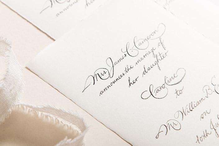 Altweißes Büttenpapier mit Spencerian Script Kalligrafie