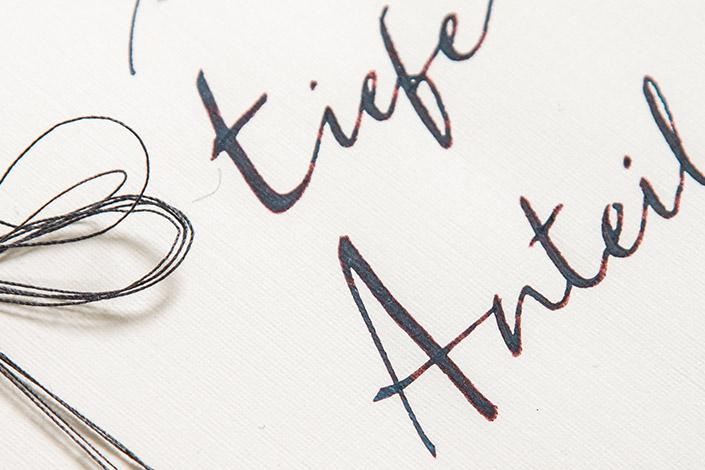 Kalligrafie Detail auf Leinenpapier