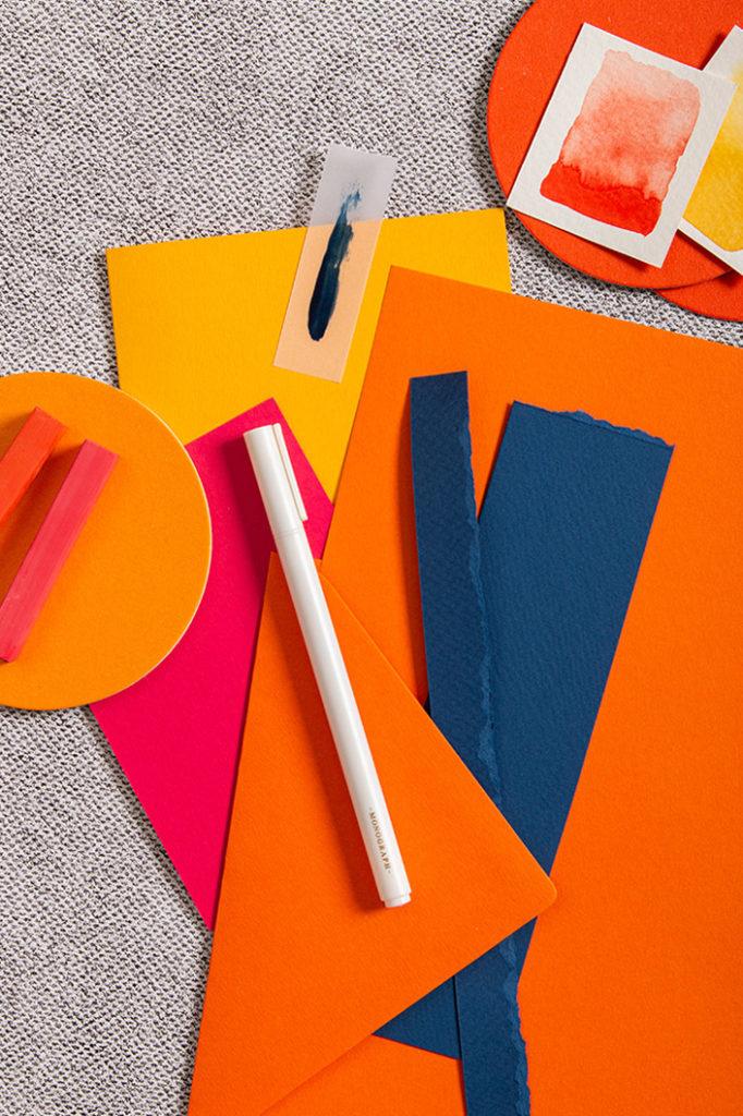 Papiere in Orange, Pink und Gelb zu Farbtrends 2021